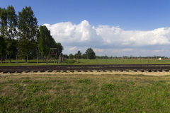 Auschwitz II -Birkenau Extermination camp outdoors and rail tracks Stock Photography