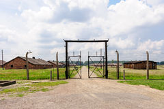 Auschwitz II - Birkenau Sector I gate. And outer perimeter electrified fence Stock Photography