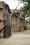 Auschwitz main entrance. Entrance gate to Auschwitz concentration camp in Poland, Europe in summer day and the famous written ARBEIT MACHT FREI from German: Work Royalty Free Stock Images