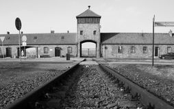 Auschwitz memorial. Auschwitz entrance with the incoming railway stock images
