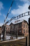 Auschwitz / Oswiecim / Poland - 02.15.2018: Entry gate to the Auschwitz Museum Concentration Camp. Entry gate with the sign Arbeit Mach Frei to the Auschwitz Royalty Free Stock Photography