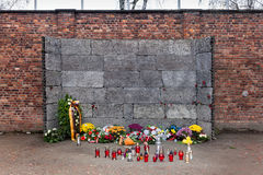 Auschwitz. Place for execution by firing squad. Auschwitz. Place for execution by firing squad with candles and flowers brought by visitors Royalty Free Stock Photography