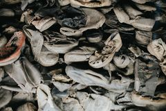 AUSCHWITZ, POLAND - DECEMBER 23, 2017: Boots of victims in Auschwitz. It is the biggest nazi concentration camp in Europe stock photo