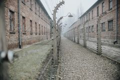 AUSCHWITZ, POLAND - DECEMBER 23, 2017: Electric fence with barbed wire in concentration camp Auschwitz-Birkenau stock photo