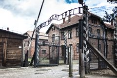 AUSCHWITZ, POLAND - July 11, 2017 ; The main gate of the concent. Ration camp Auschwitz with the inscription work makes you free Royalty Free Stock Image