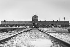 AUSCHWITZ, POLAND - July 11, 2017.Rail entrance to concentration. Camp at Auschwitz Birkenau KZ Poland,classic historical view of Auschwitz death camp in black Royalty Free Stock Image
