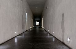 Auschwitz, Poland - 06.15.2017: Long perspective and shadows on walls in corridor of Death campus in Auschwitz concentration camp. As memory of fascizm victims Stock Photography