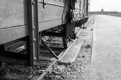 Main entrance to Auschwitz Birkenau Nazi Concentration Camp, showing one of the cattle cars used to bring victims to their death stock image