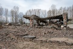 Photograph of the remains of one of the crematoria at Auschwitz German Concentration Camp, Poland stock photography