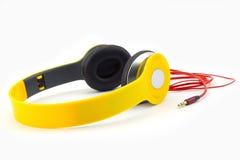 Auscultadores amarelos Imagens de Stock Royalty Free