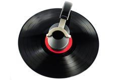 Auscultadores e disco velho Foto de Stock Royalty Free