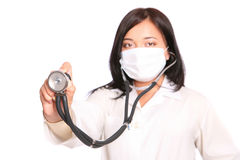 Auscultation. Asian doctor with a stethoscope over white background stock photo