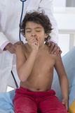 Auscultation Child. Pediatrist makes chest auscultation to little boy royalty free stock photo