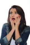 Ausdrücke. Junge attraktive Frau überrascht Stockbilder