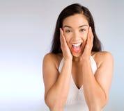 Ausdruck einer Frau, die etwas groß gewinnt Stockbilder