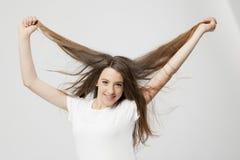 Ausdruck eines wirklichen jungen Mädchens Stockfoto