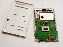 Auseinandergebaute Platte auf einem weißen Hintergrund lizenzfreies stockbild