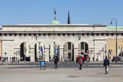 Auseres Burgtor Gate monument in Vienna. VIENNA, AUSTRIA - APR 24, 2015: people pass the Auseres Burgtor Gate monument in Vienna, Austria. It was build in 1821 Royalty Free Stock Images