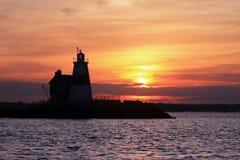 Ausführung schaukelt Leuchtturm-Sonnenuntergang Lizenzfreie Stockfotos