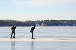 Ausflug-Schlittschuhläuferpaare an der hohen Geschwindigkeit Lizenzfreie Stockfotografie