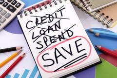 Ausgaben- und Einsparungsmitteilung Lizenzfreie Stockfotografie