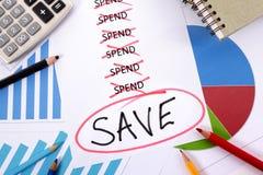 Ausgaben- und Einsparungsmitteilung Stockfoto