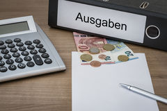 Ausgaben written on a binder Stock Photography