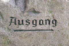 Ausgang sign on the surface of a rock Stock Images