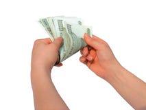 Ausgeben des Geldes Stockbild