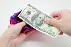 Ausgeben etwas Geldes Stockbild