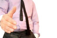 Ausgedehnte Hand des Geschäftsmannes Stockbild