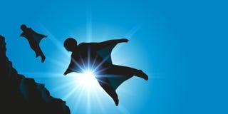 Ausgerüstet mit einem Wingsuit, machen zwei Fallschirmspringer niedrigen Sprung lizenzfreie abbildung