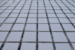 Ausgewählter Fokus der alten Beschaffenheit des Mosaikfußbodenhintergrundes mit flacher Schärfentiefe mit Kopienraum addieren Sie Lizenzfreie Stockfotos