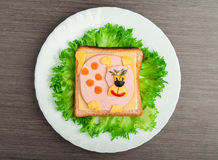 Auslegungsnahrung. Kreatives Sandwich für Kind mit Abbildung wenig PU Stockbild