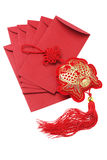 Auspicious Fish Ornament And Red Packets Stock Photo