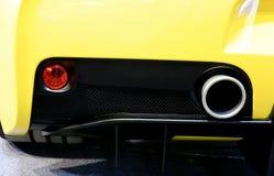 Auspuffrohr von gelbem Ferrari Stockfotografie
