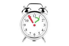 Ausruf und Fragezeichen auf der Alarmuhr Stockfotos