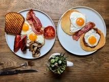 Aussie / Australian Breakfast with Brioche Toast, Fried Eggs, Crispy Bacon Sausage, Salty Pancakes and Mushrooms. Organic Foods stock photo