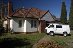 Aussie house. Small australian typical house, white van in front of it Stock Photography