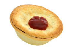 Aussie Meat Pie and Sauce. Traditional Aussie Meat Pie with Tomato Sauce.  Isolated on white.  Football food Royalty Free Stock Photos
