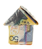 Aussie Mortgage. Australian Money - Aussie currency folded into the shape of a small house on a white background Stock Photo