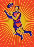 Aussie rules player jumping catching ball Stock Images