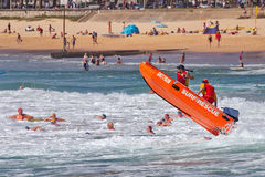 Aussie surf lifesaver in big waves Royalty Free Stock Image