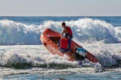 Aussie surf lifesaver in big waves Stock Photos