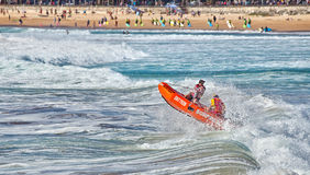 Aussie surf lifesaver in big waves Stock Photography
