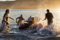 Aussie surf lifesavers training. BARRENJOEY,AUSTRALIA - MAY 25,2014: Members of the local surf lifesaving club practice their boat drills in the Pittwater Stock Images