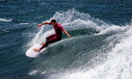 Aussie surfer rides a big wave Stock Image
