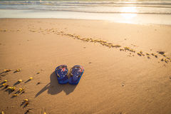Aussie thongs on the beach at sunset. Thongs with Australian flag on the beach at sunset Royalty Free Stock Photos