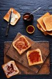Aussie toasts with butter and marmite. Delicious aussie toasts with butter and marmite - yeast extract, a thick Australian healthy food spread made from leftover Stock Images
