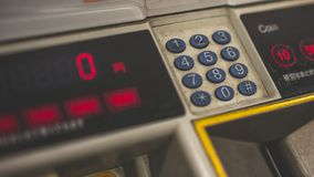 Austausch-Münzen-Tauschen-Spiel-Maschine lizenzfreie stockfotografie